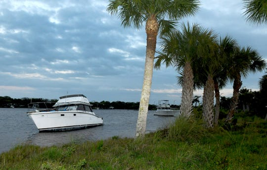 Derelict boats along the Brevard shoreline, including this one in the Indian River Lagoon just north of Turkey Creek in Palm Bay.