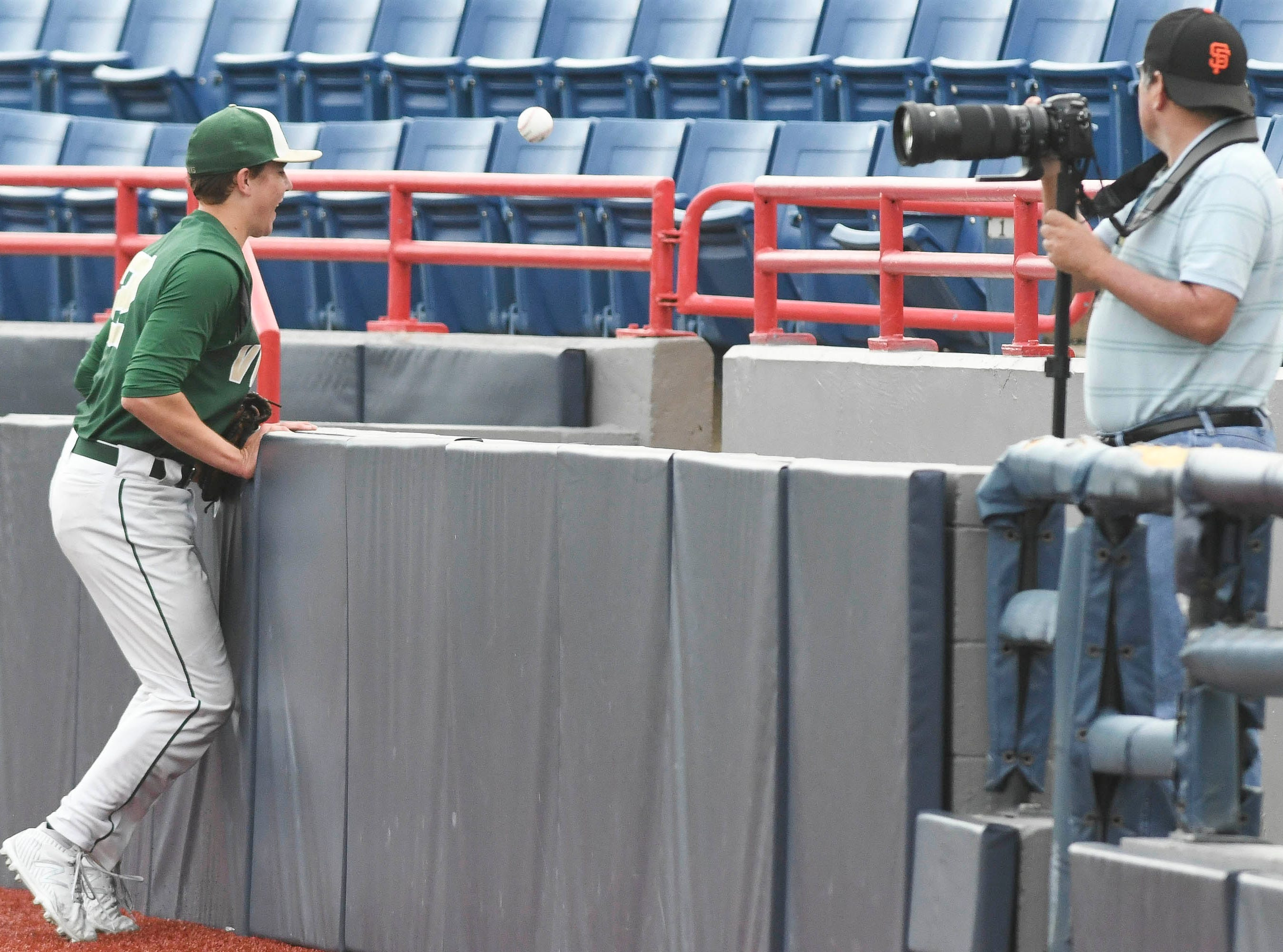 Brady Janssen of Viera chases a foul ball out of bounds during Wednesday's game against Sebastian River.