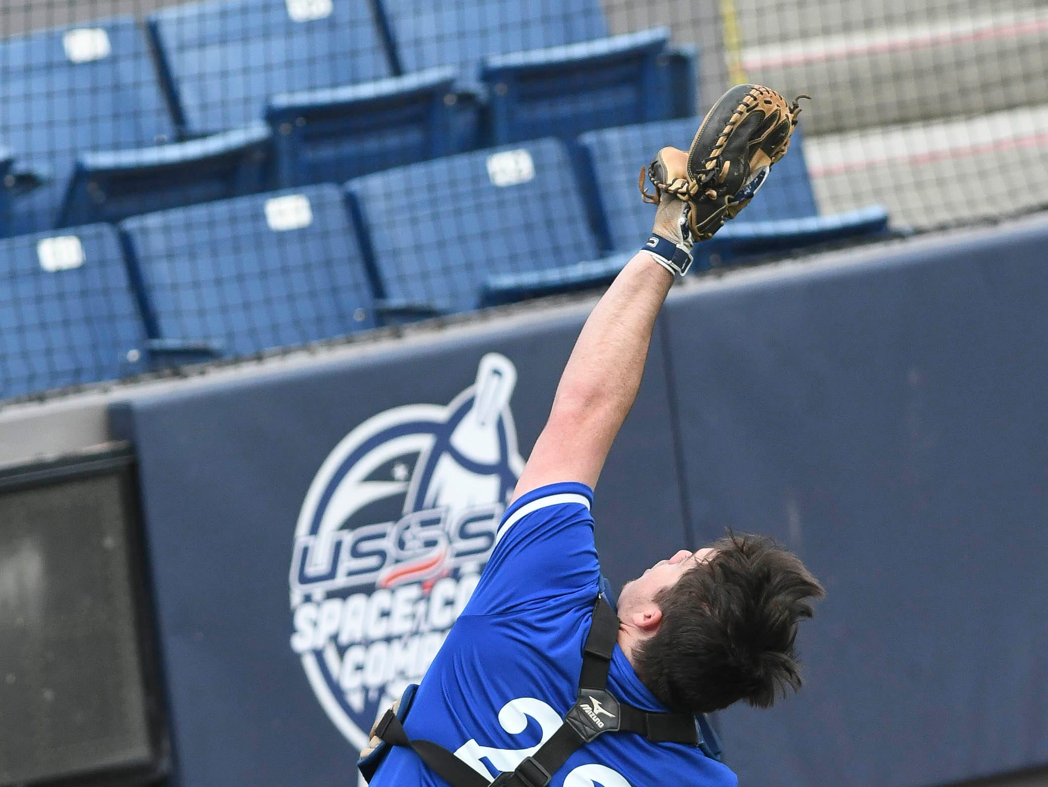 Sebastian River catcher Greg Young tracks down a foul ball during Wednesday's game at USSSA Space Coast Stadium.