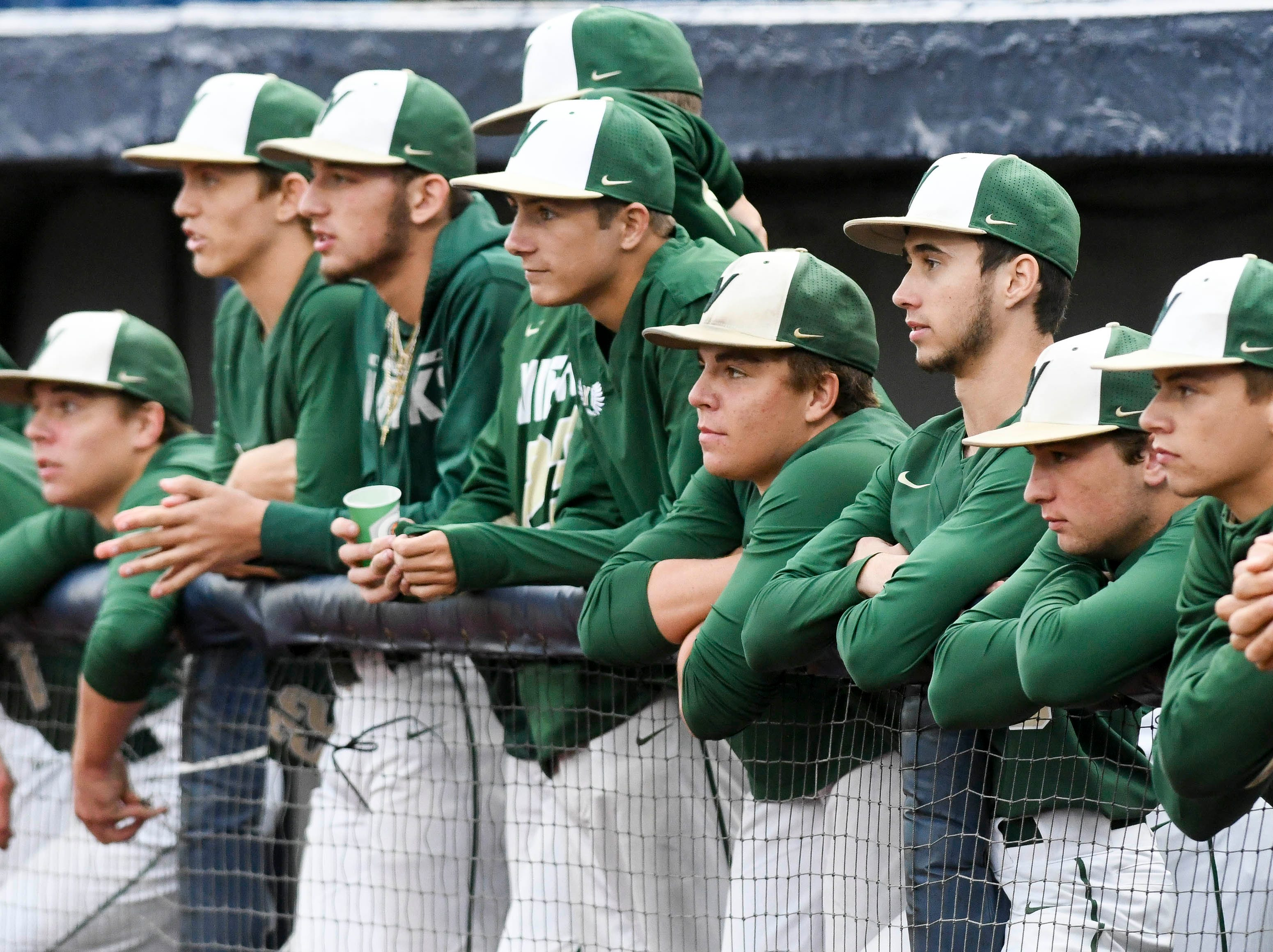 Viera players watch the game action from the bench during Wednesday's game at USSSA Space Coast Stadium.