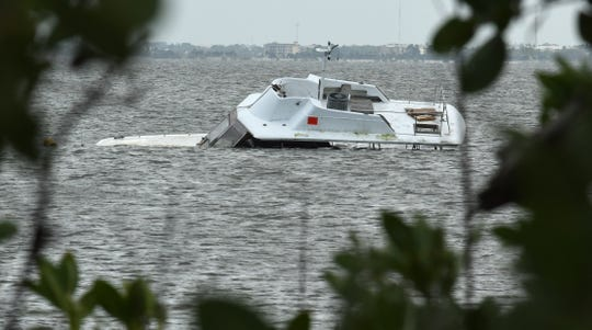 Derelict boats along the Brevard shoreline include this one south of the Eau Gallie boat ramp.