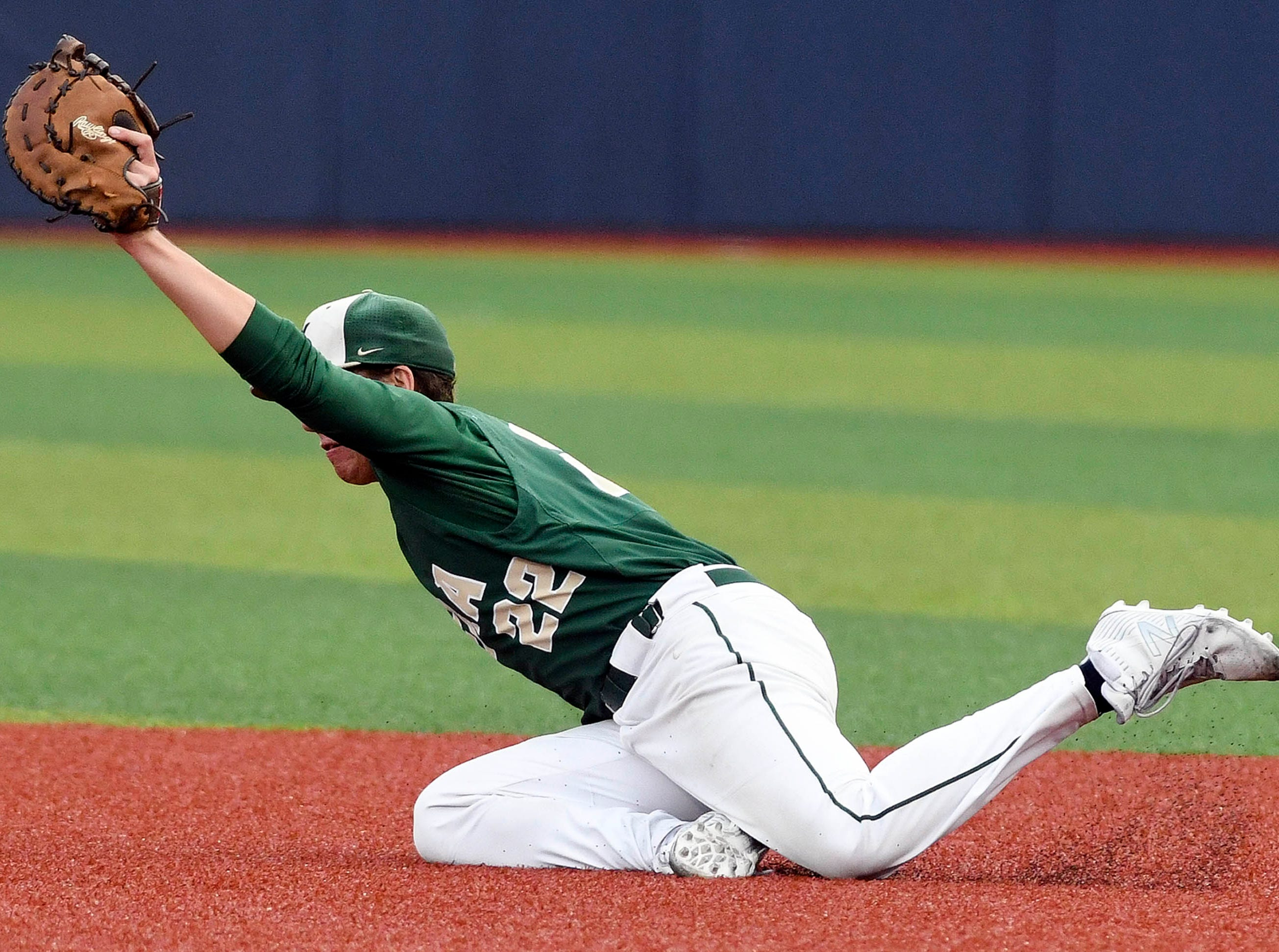 Brady Janssen of Viera makes a diving catch during Wednesday's game at USSSA Space Coast Stadium.