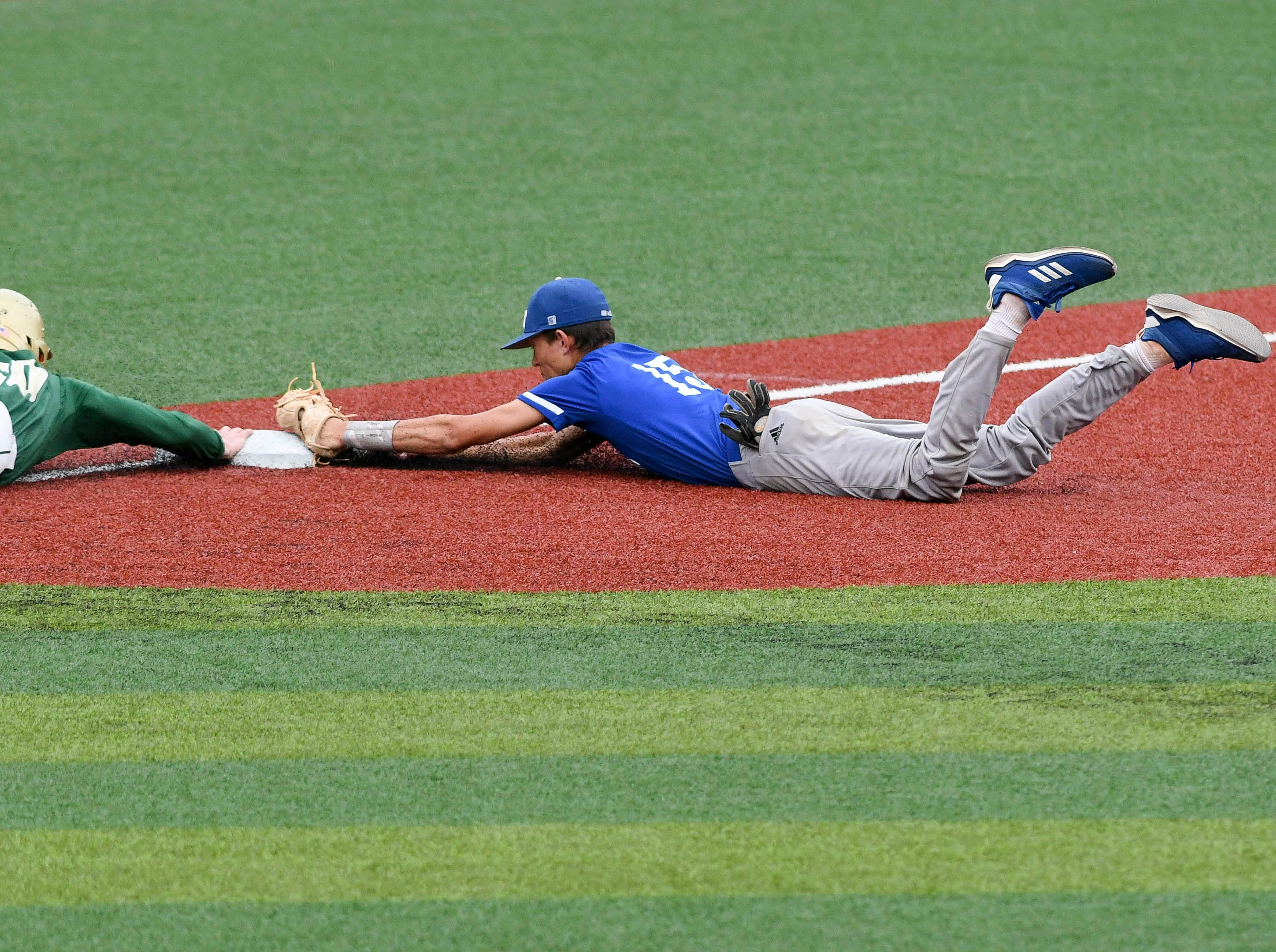 JT Muller of Sebastian River beats Viera's JT Smith back to third to complete a double play during Wednesday's game at USSSA Space Coast Stadium.