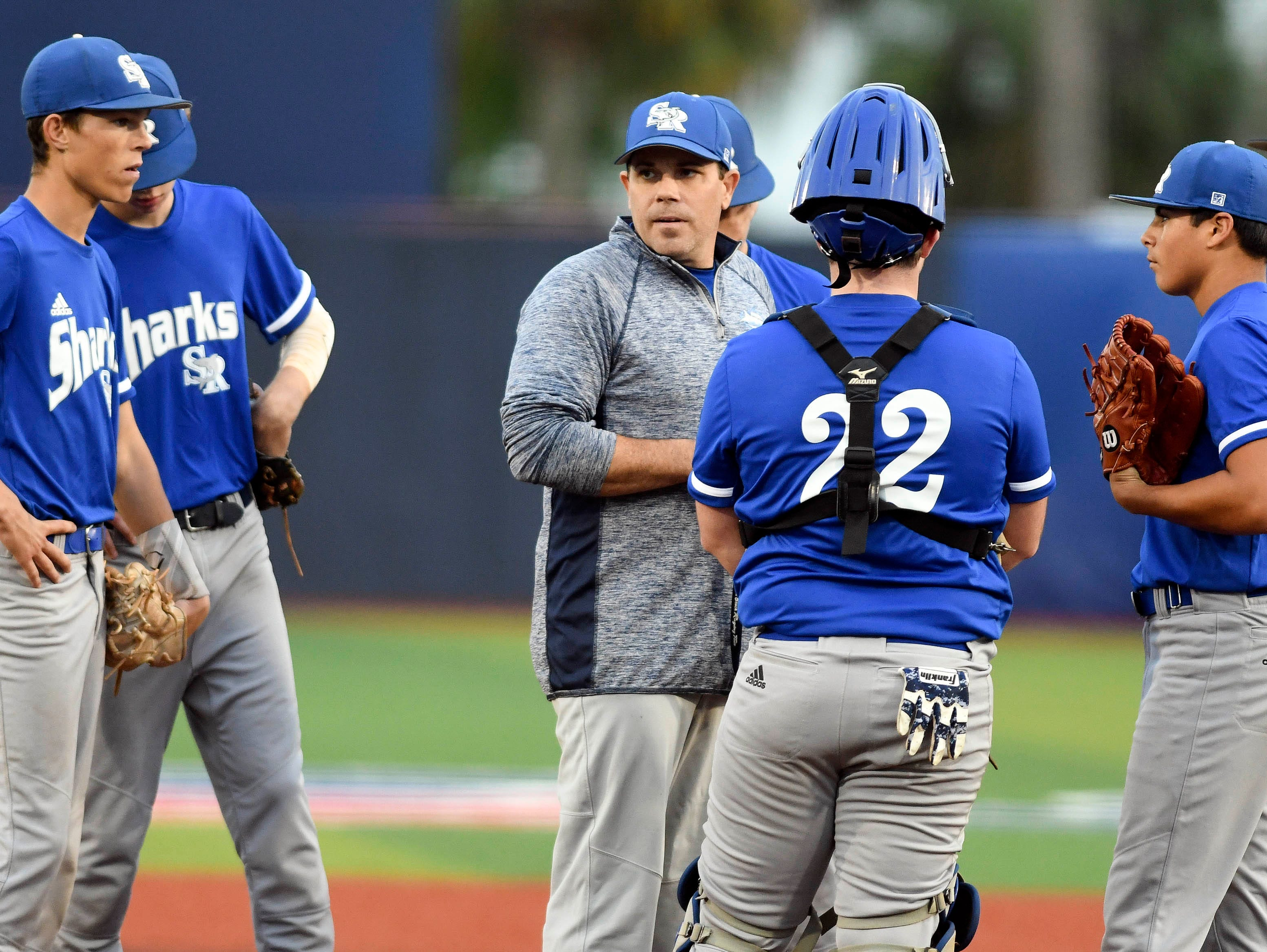 Sebastian River baseball coach talks with his team during Wednesday's game against Viera at USSSA Space Coast Stadium.