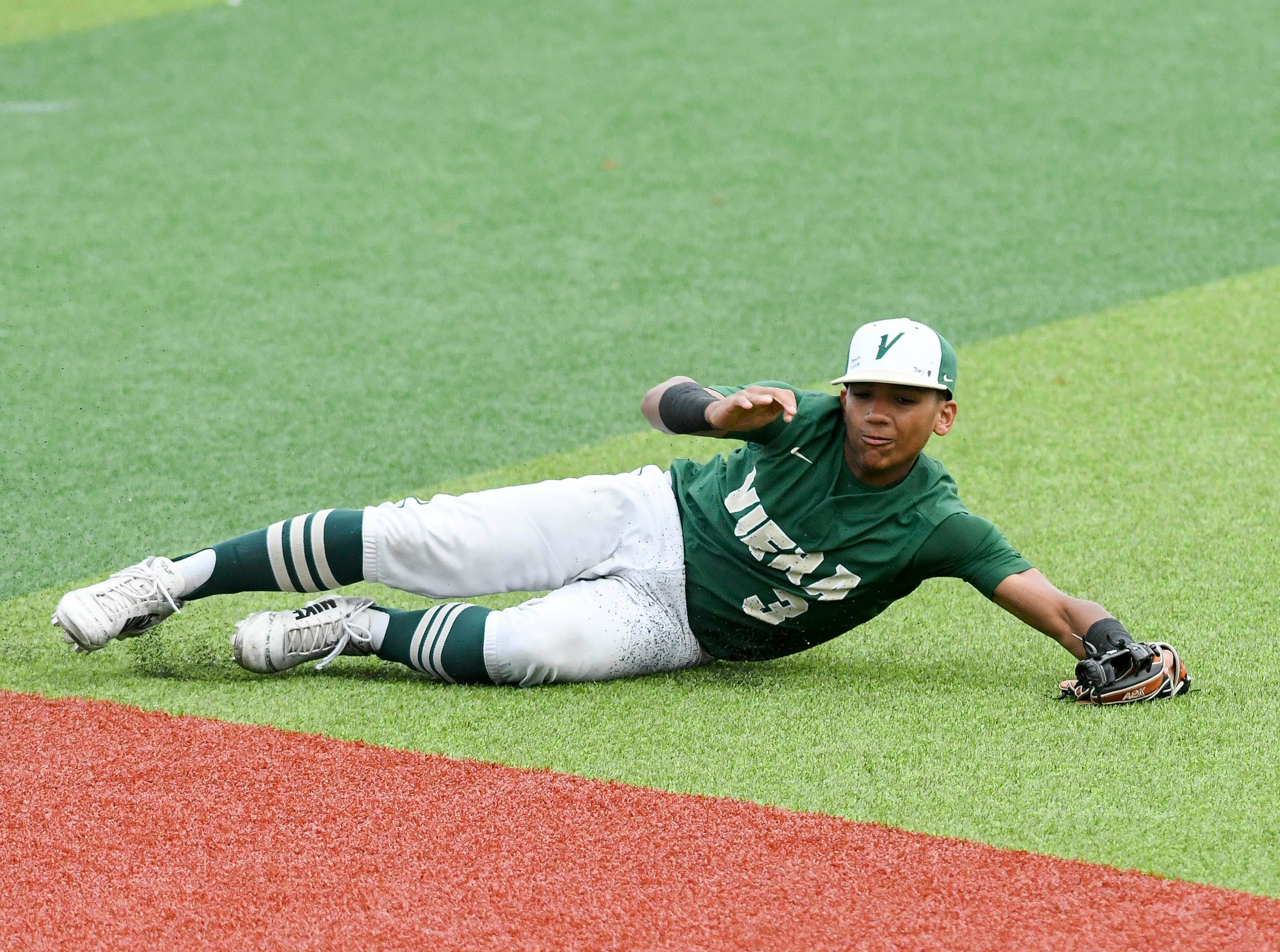 Edian Espinal of Viera is unable to come up with a line drive grounder during Wednesday's game against Sebastian River at USSSA Space Coast Stadium.