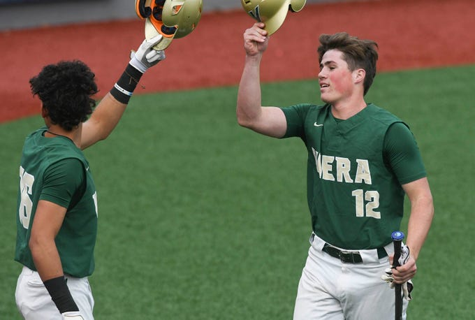 Viera's Alan Espinal high fives teammate Zach Taylor during Wednesday's game at USSSA Space Coast Stadium.