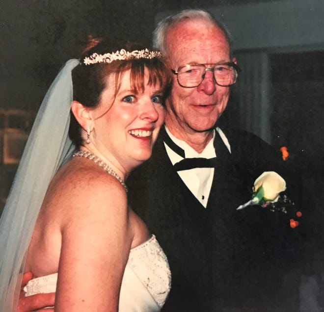Suzy Fleming Leonard dances with her father, Ellis Fleming, at her wedding on March 20, 2014.