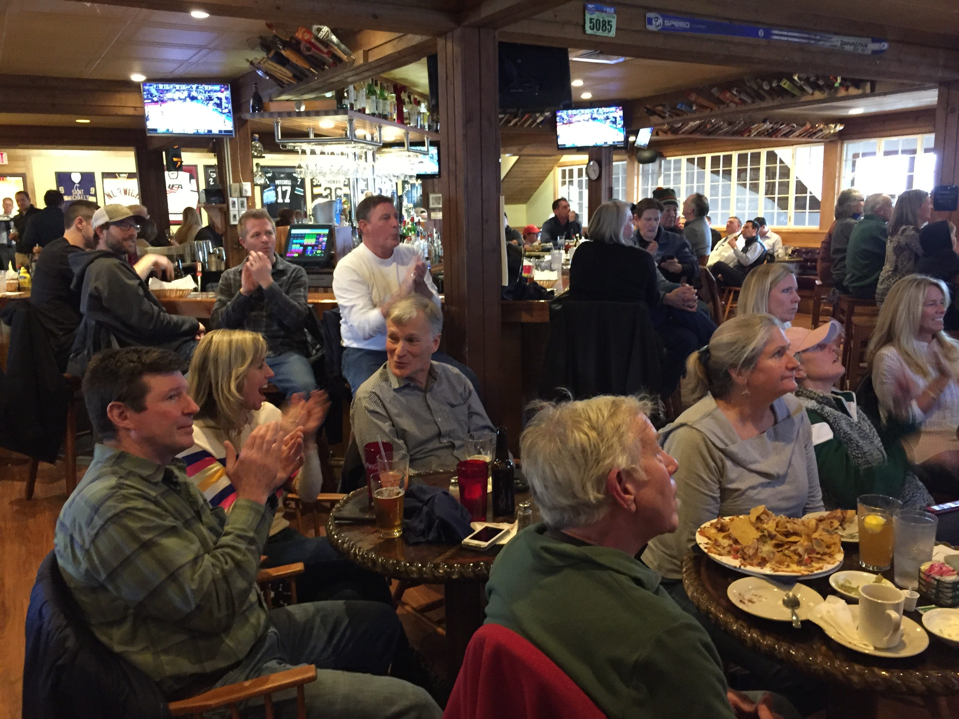 Fans at The Windjammer Restaurant and Upper Deck Pub in South Burlington cheer as the University of Vermont plays Florida State in an NCAA basketball tournament game Thursday, March 21, 2019.