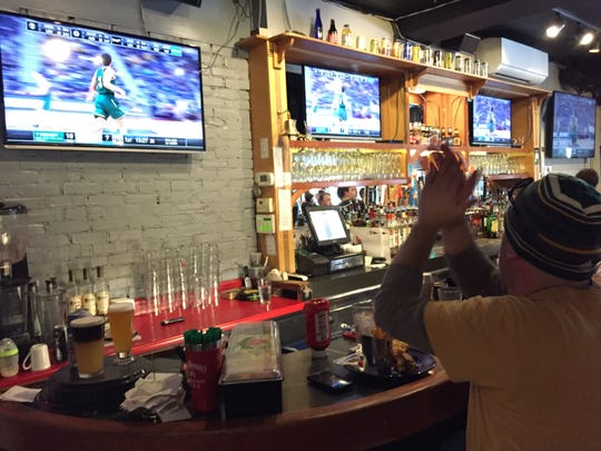 Harry Benoit of Burlington claps at the Church Street Tavern as the University of Vermont men's basketball team jumps out to an early lead against Florida State on Thursday, March 21, 2019.