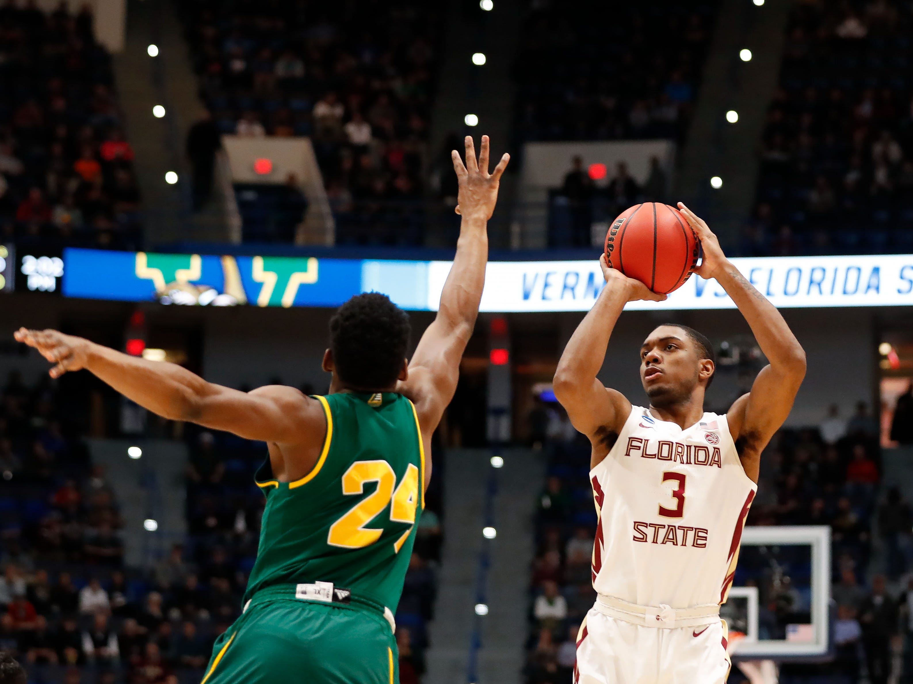 Mar 21, 2019; Hartford, CT, USA; Florida State Seminoles guard Trent Forrest (3) attempts a shot over Vermont Catamounts guard Ben Shungu (24) during the first half of a game in the first round of the 2019 NCAA Tournament at XL Center. Mandatory Credit: David Butler II-USA TODAY Sports