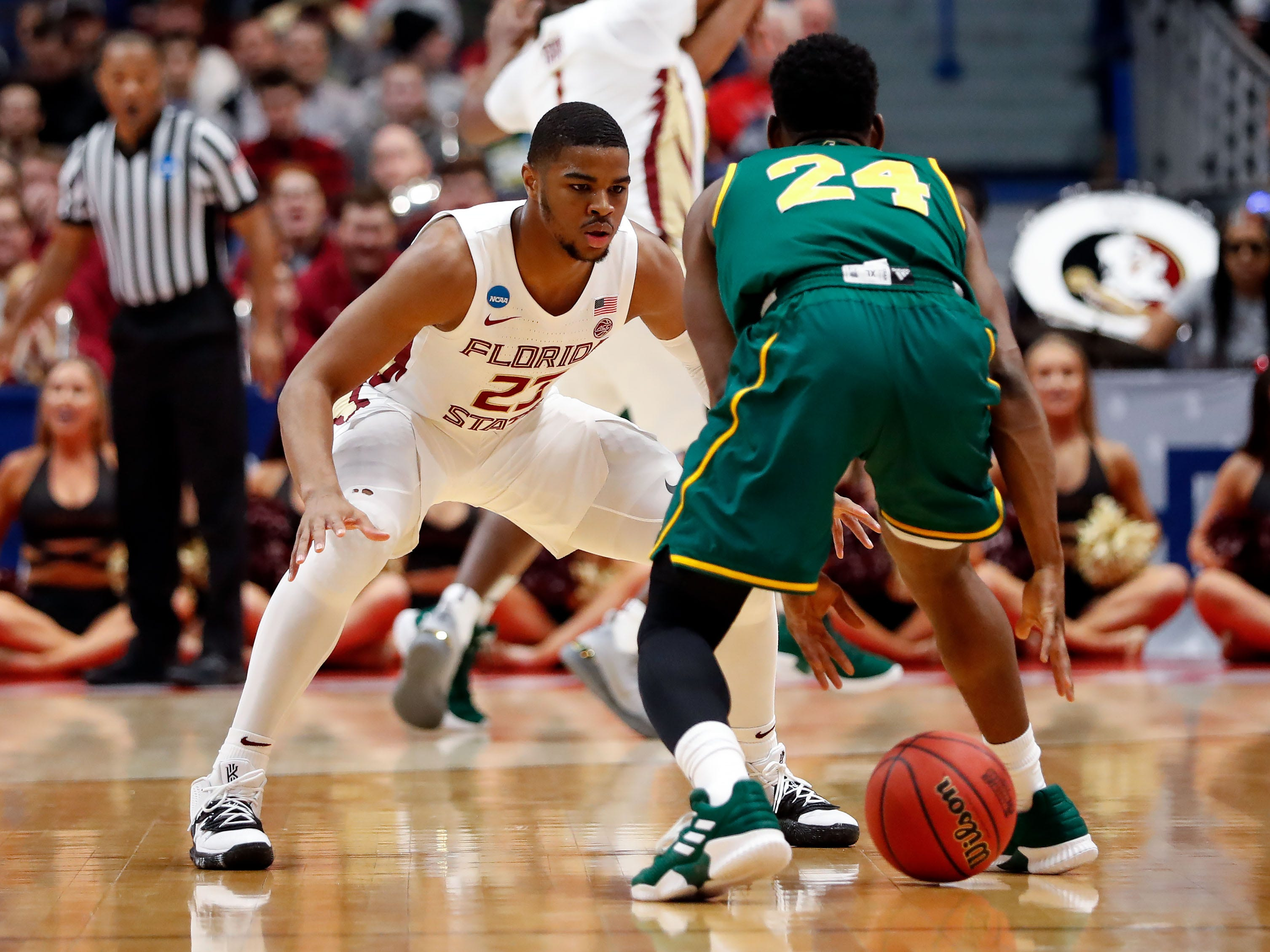 Mar 21, 2019; Hartford, CT, USA; Florida State Seminoles guard M.J. Walker (23) defends Vermont Catamounts guard Ben Shungu (24) during the first half of a game in the first round of the 2019 NCAA Tournament at XL Center. Mandatory Credit: David Butler II-USA TODAY Sports