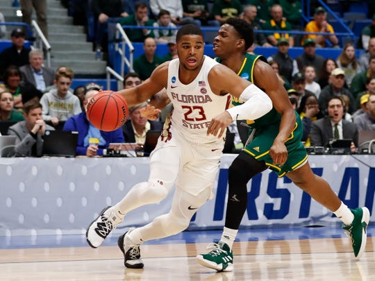Mar 21, 2019; Hartford, CT, USA; Florida State Seminoles guard M.J. Walker (23) drives to the basket around Vermont Catamounts guard Ben Shungu (24) during the first half of a game in the first round of the 2019 NCAA Tournament at XL Center. Mandatory Credit: David Butler II-USA TODAY Sports