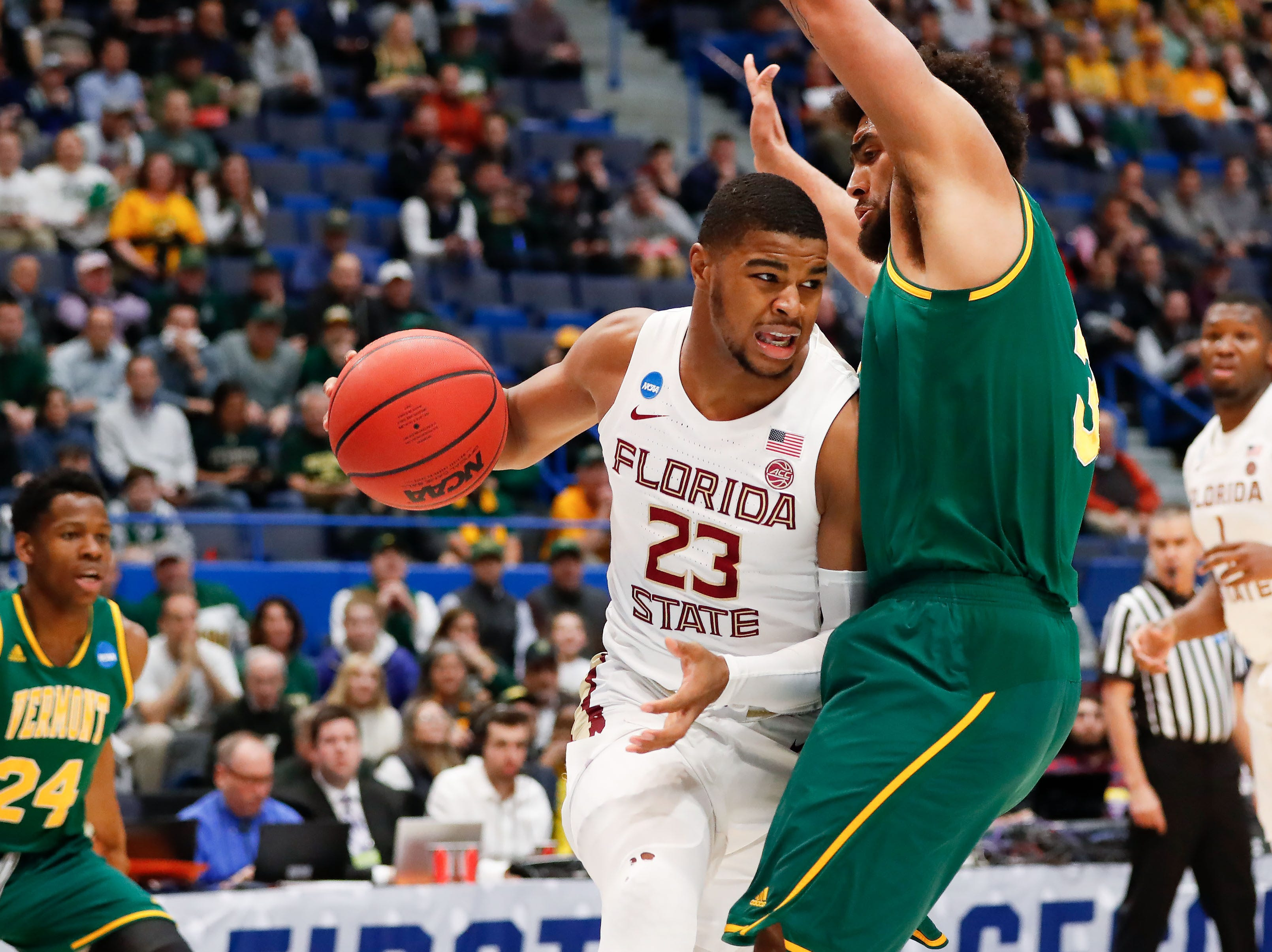 Mar 21, 2019; Hartford, CT, USA; Florida State Seminoles guard M.J. Walker (23) drives to the basket against Vermont Catamounts forward Anthony Lamb (3) during the first half of a game in the first round of the 2019 NCAA Tournament at XL Center. Mandatory Credit: David Butler II-USA TODAY Sports