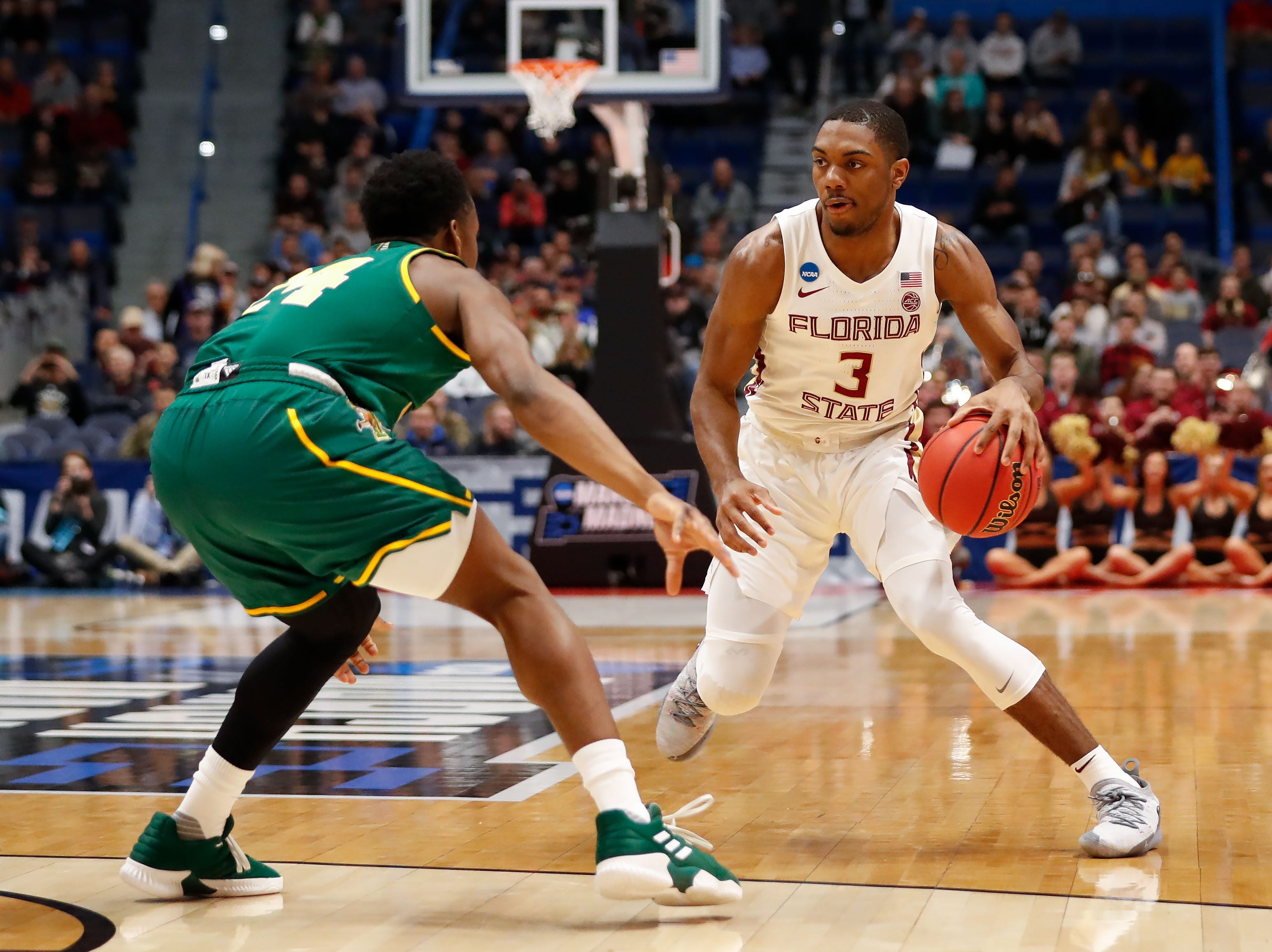 Mar 21, 2019; Hartford, CT, USA; Florida State Seminoles guard Trent Forrest (3) controls the ball in front of Vermont Catamounts guard Ben Shungu (24) during the first half of a game in the first round of the 2019 NCAA Tournament at XL Center. Mandatory Credit: David Butler II-USA TODAY Sports