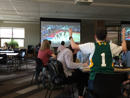 Ian Denis, a University of Vermont sophomore from McLean, Virginia, reacts at the University of Vermont Davis Center while watching the UVM men's basketball game against Florida State on Thursday, March 21, 2019.