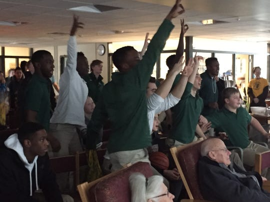 Students at Rice Memorial High School in South Burlington cheer as the University of Vermont men's basketball team plays an NCAA tournament game against Florida State on Thursday, March 21, 2109.