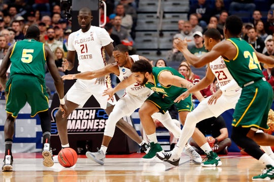 Mar 21, 2019; Hartford, CT, USA; Vermont Catamounts forward Anthony Lamb (3) and Florida State Seminoles guard Trent Forrest (3) reach for a loose ball during the first half of a game in the first round of the 2019 NCAA Tournament at XL Center. Mandatory Credit: David Butler II-USA TODAY Sports