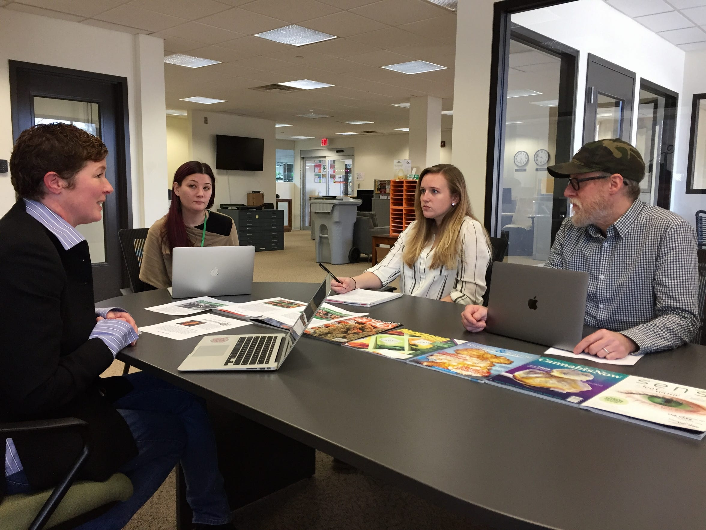 Bridget Conry leads a marketing team meeting at the CVD, Inc. production facility. The conversation touched on how much the company should emphasize April 20, an unofficial marijuana holiday.