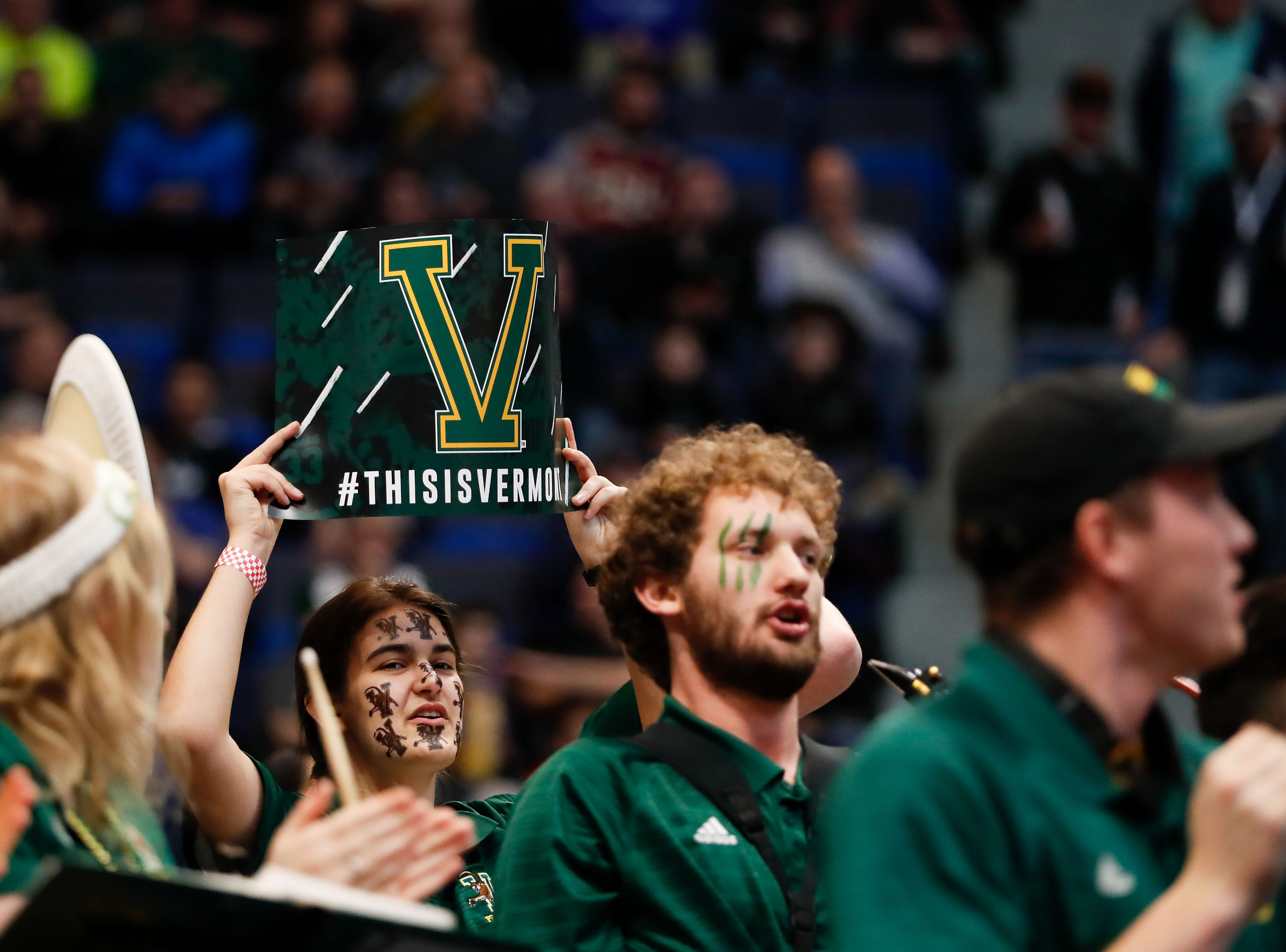 Mar 21, 2019; Hartford, CT, USA; A member of the Vermont Catamounts band hold up a sign during a game against the Florida State Seminoles in the first round of the 2019 NCAA Tournament at XL Center. Mandatory Credit: David Butler II-USA TODAY Sports