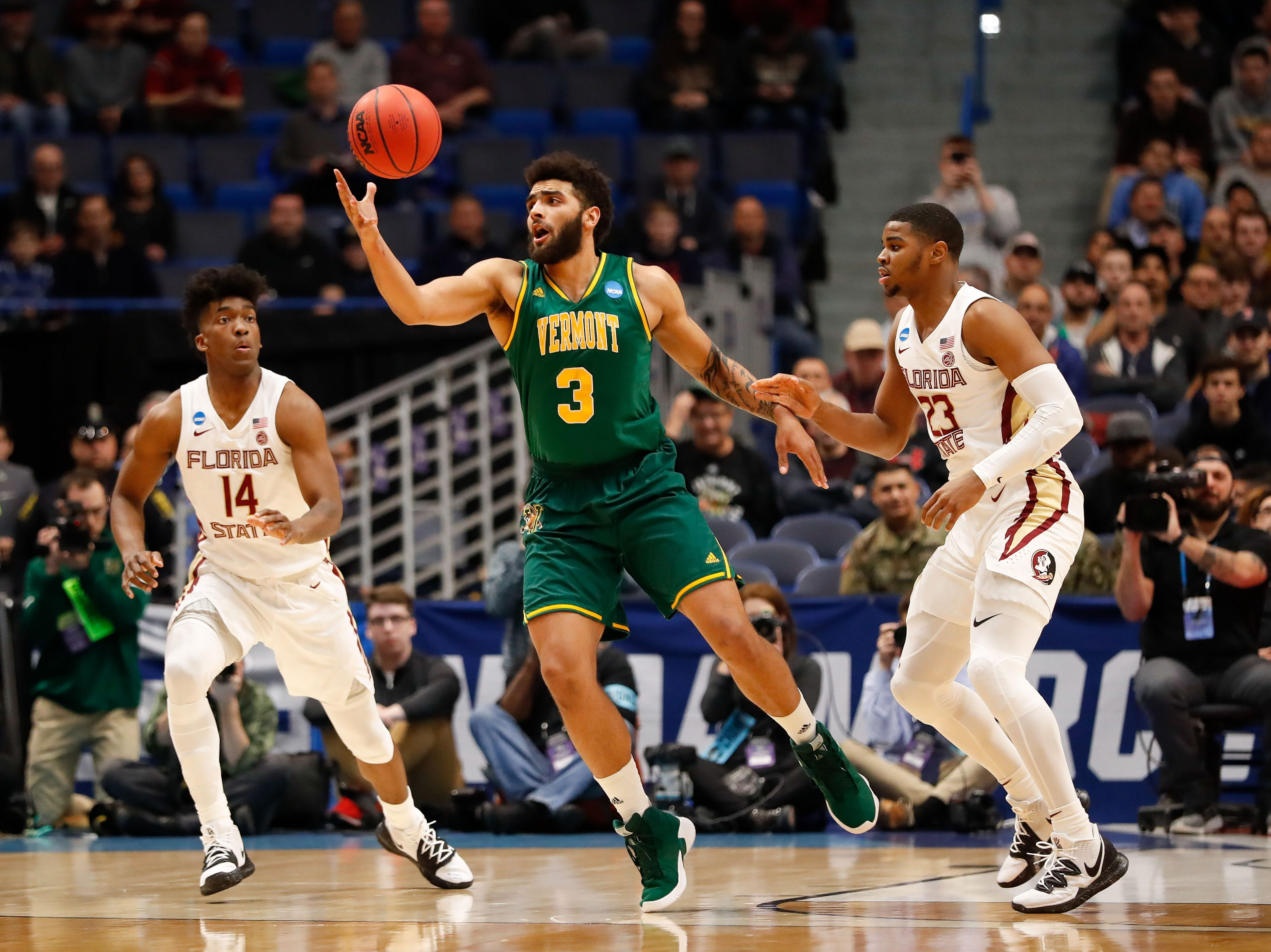 Mar 21, 2019; Hartford, CT, USA; Vermont Catamounts forward Anthony Lamb (3) catches a pass in between Florida State Seminoles guard M.J. Walker (23) and guard Terance Mann (14) during the first half of game in the first round of the 2019 NCAA Tournament at XL Center. Mandatory Credit: David Butler II-USA TODAY Sports
