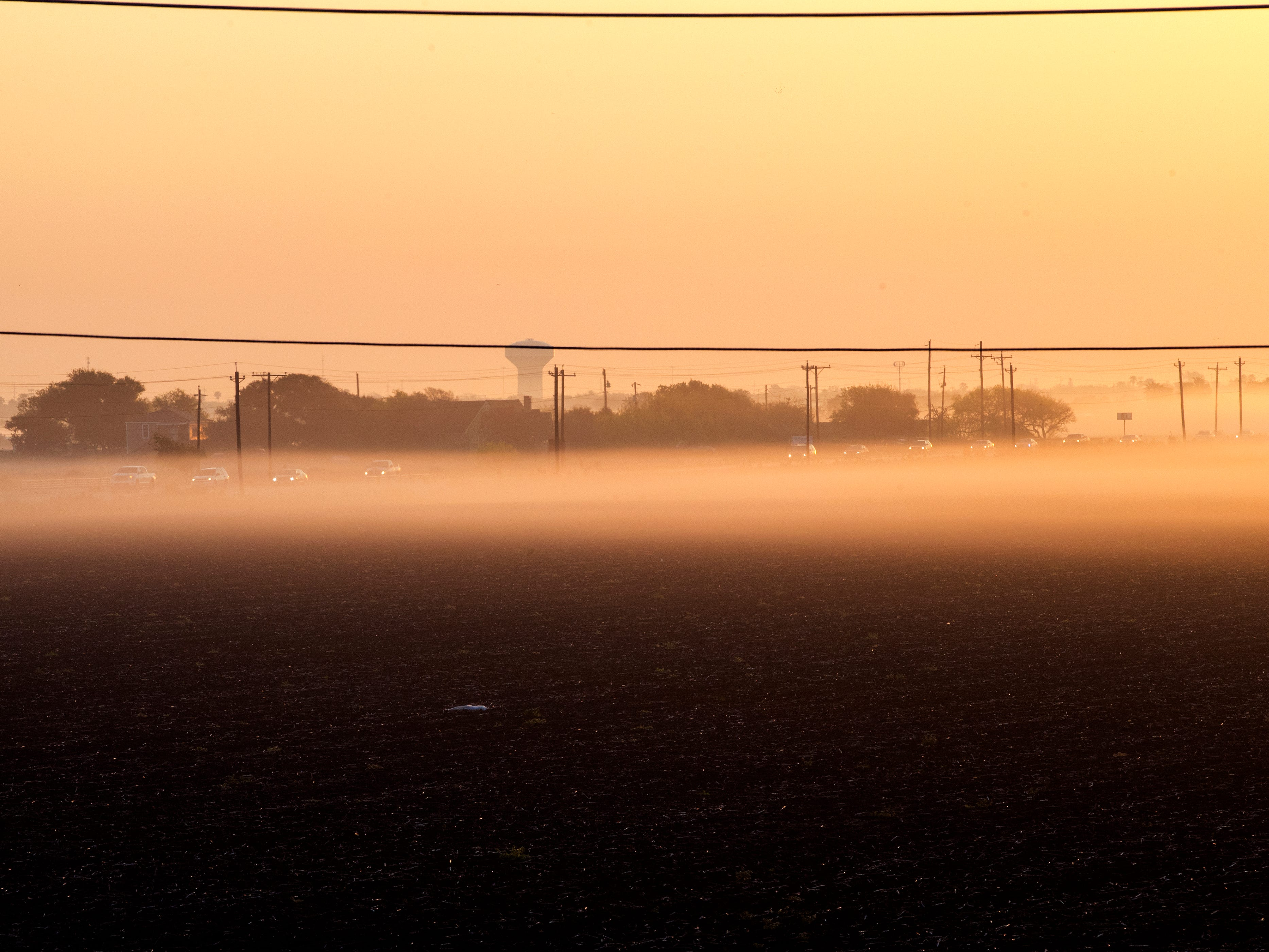 Vehicles travel along Farm Road 43 as fog covers the southside on Thursday, March 21, 2019.