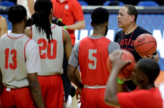 Houston head coach Kelvin Sampson talks to his team during practice for the NCAA men's college basketball tournament Thursday, March 21, 2019, in Tulsa, Okla. (AP Photo/Charlie Riedel)