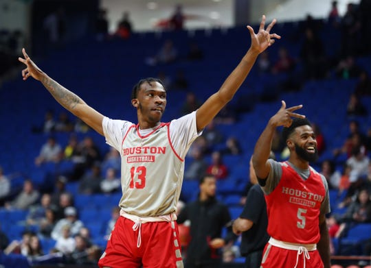 Mar 21, 2019; Tulsa, OK, USA; Houston Cougars guard Dejon Jarreau (13) and teammate Corey Davis Jr. (5) react as they practice before the first round of the 2019 NCAA Tournament at BOK Center. Mandatory Credit: Mark J. Rebilas-USA TODAY Sports