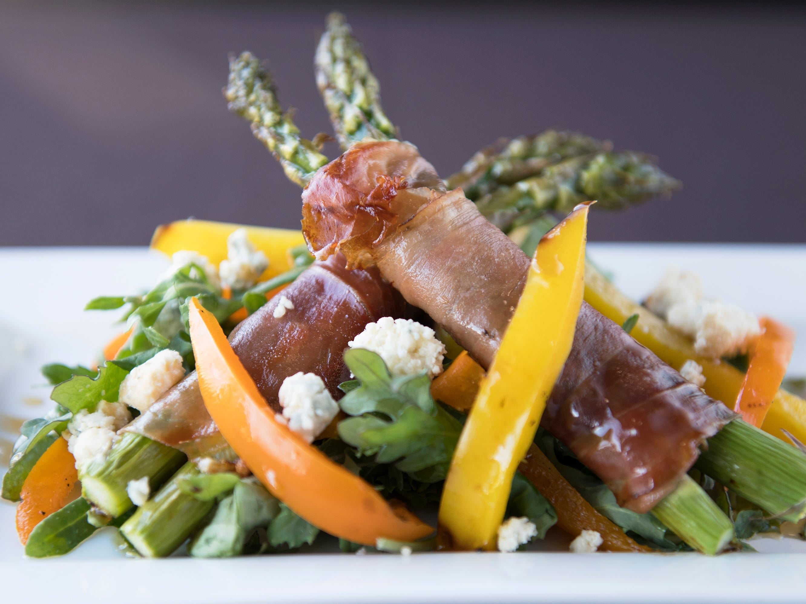 Warm asparagus and specht with smoked bleu cheese, roasted peppers, baby kale, and honey balsamic dressing is a second course option on the SJ Hot Chefs' Spring Restaurant Week menu of Anthony's Creative Italian Cuisine in Haddon Heights.