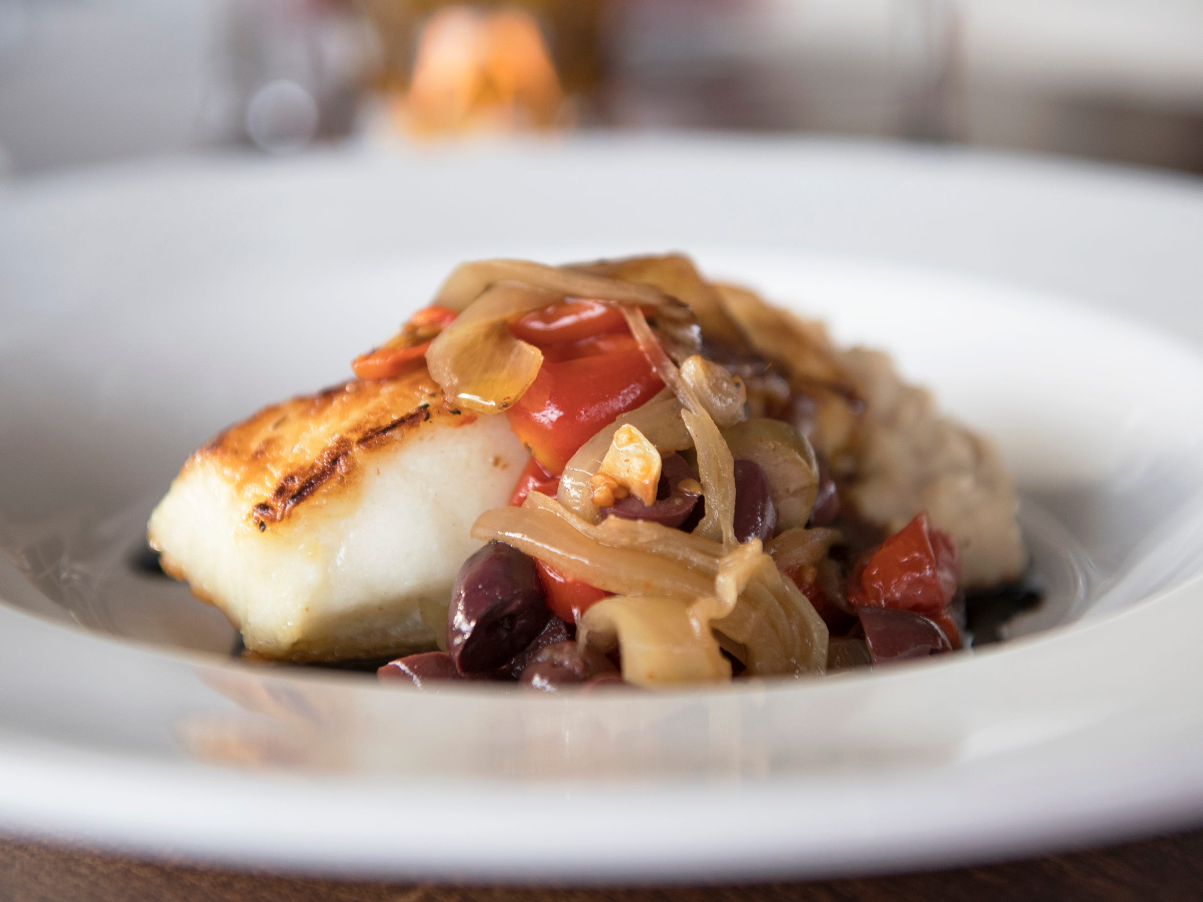 Chilean sea bass served over white bean puree, topped with tomato caponata, with balsamic glaze, is an entree option on the SJ Hot Chefs' Spring Restaurant Week menu of L'Oceano Ristorante in Collingswood.