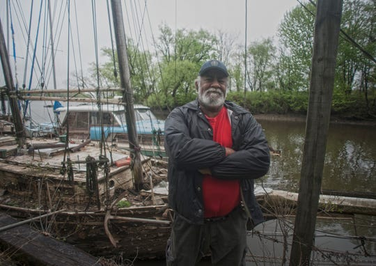 Rod Sadler poses for a photo near a wooden ship at his home in North Camden. He was harbormaster for Wiggins Waterfront Park Marina and had a lifelong love of boats.
