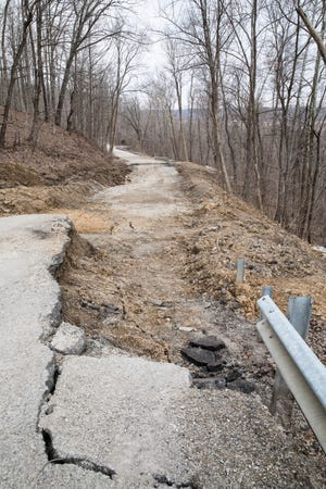 A season of heavy rain caused a section of Blain Highway to slip and become undrivable in Huntington Township.