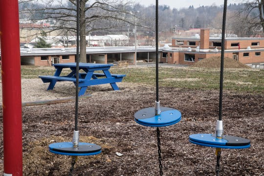 One of Allen Elementary' s  school playgrounds sits on top of a hill behind the school and  overlooks the current demolition progress of the school, which was originally dedicated on Sunday, November 12, 1961.