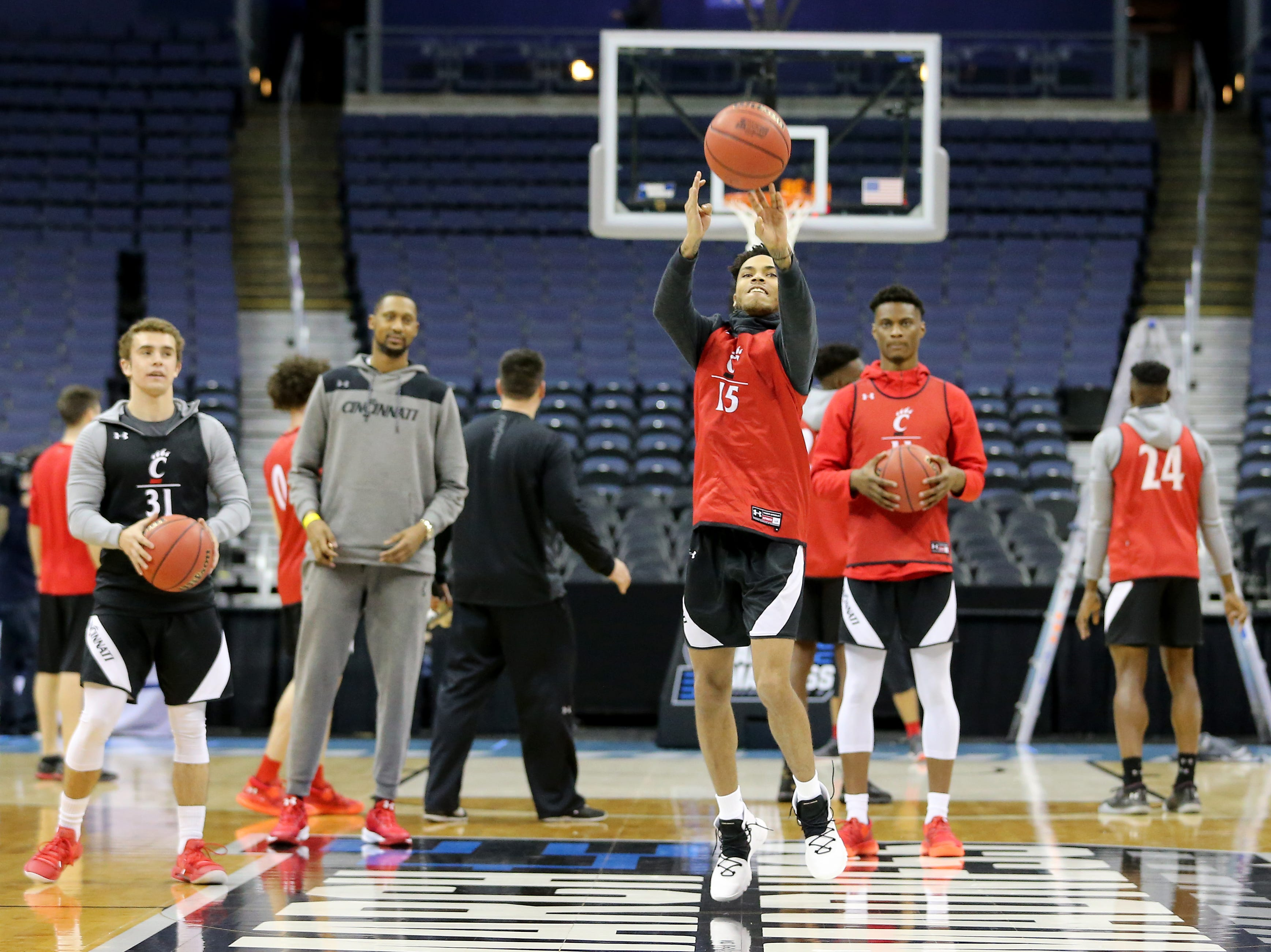 Cincinnati Bearcats guard Cane Broome (15) takes a half-court shot open practice, Thursday, March 21, 2019, at Nationwide Arena in Columbus, Ohio.
