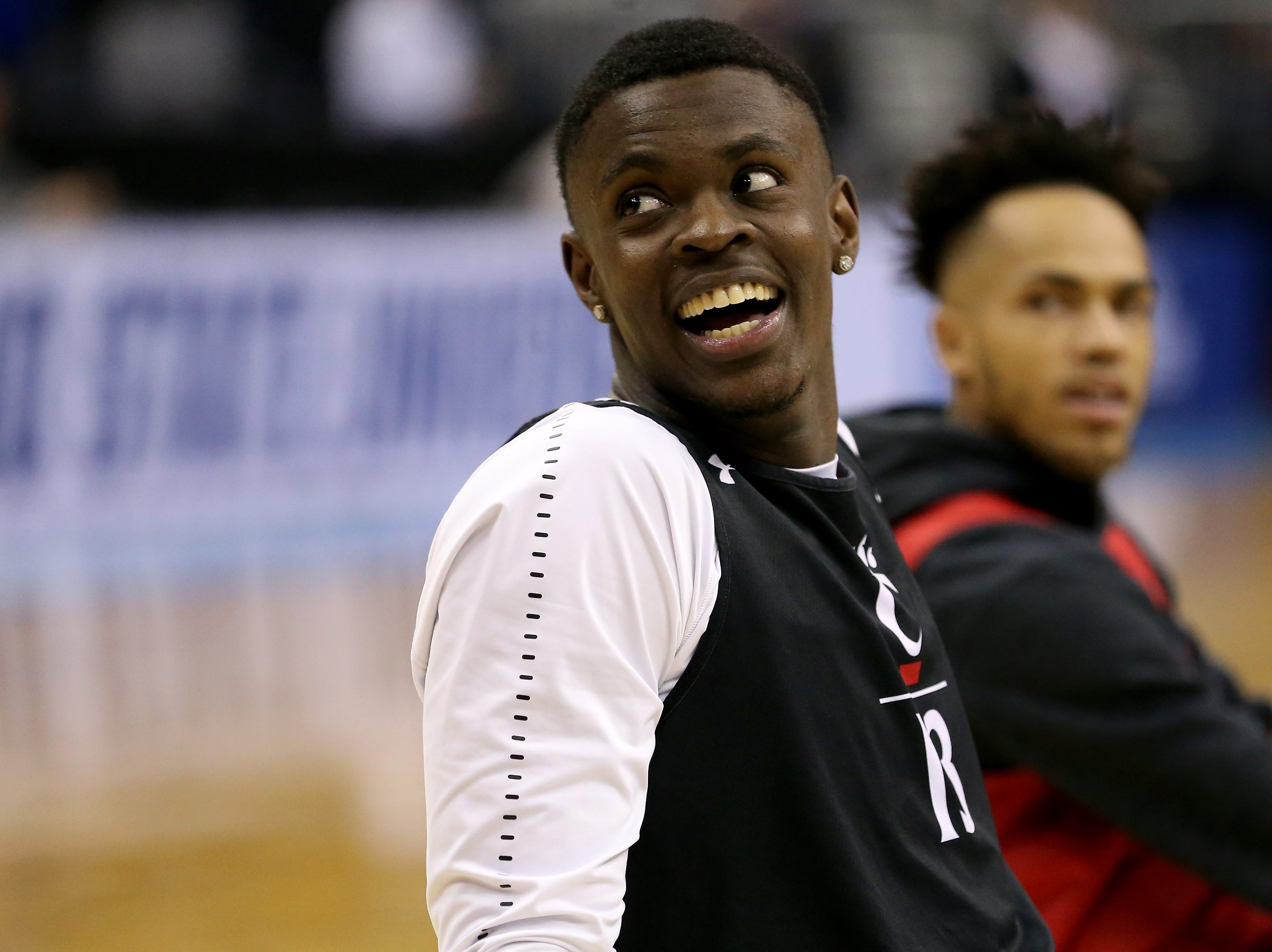 Cincinnati Bearcats forward Tre Scott (13) smiles during stretching before open practice, Thursday, March 21, 2019, at Nationwide Arena in Columbus, Ohio.