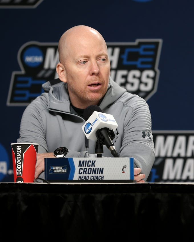 Cincinnati Bearcats head coach Mick Cronin answers questions from the media, Thursday, March 21, 2019, at Nationwide Arena in Columbus, Ohio.