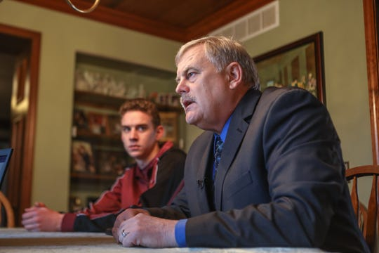 Jerome Kunkel, 18, left, and his father, Bill, talk about the chickenpox outbreak at the small private Assumption Academy in Walton, Kentucky. Jerome, who is not immune from chickenpox, refuses to get the vaccination because it is made from the replicated cells of a fetus legally aborted half a century ago. He has sued health authorities for violating his constitutional freedom of religion.