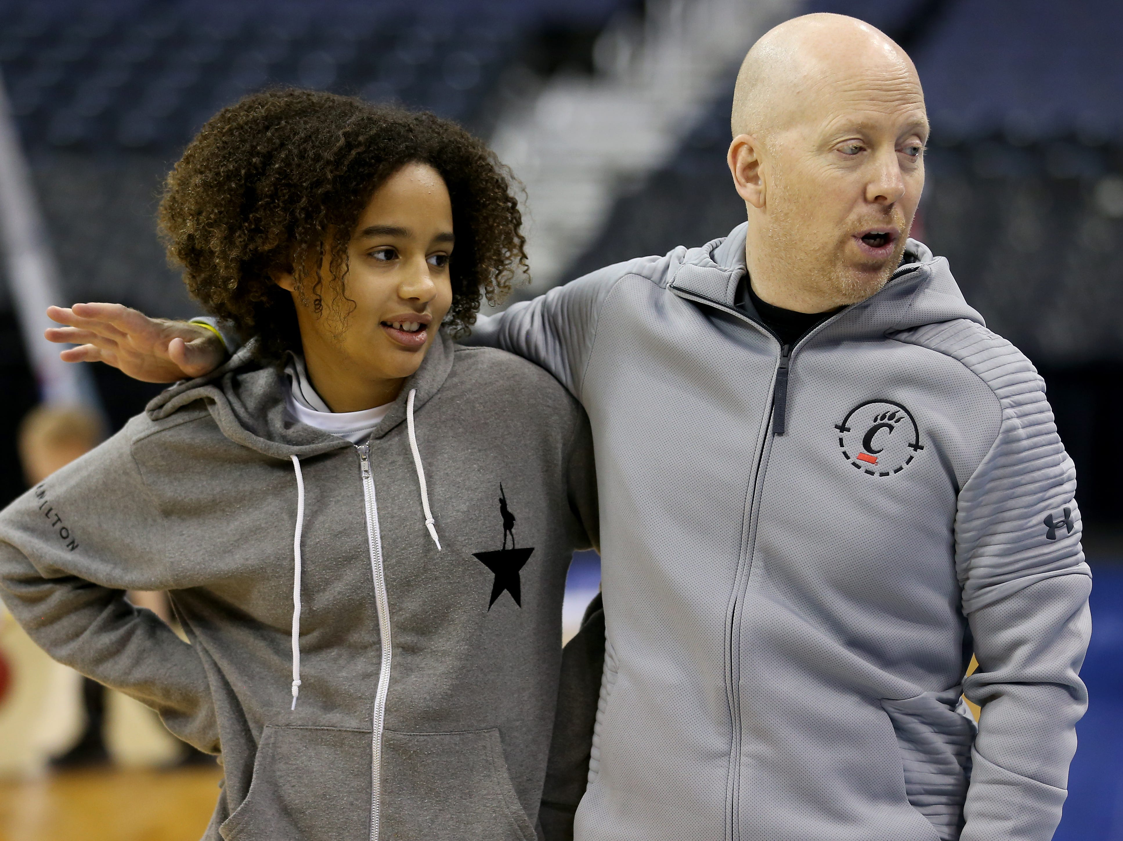 Cincinnati Bearcats head coach Mick Cronin embraces his daughter, Sammi, during open practice, Thursday, March 21, 2019, at Nationwide Arena in Columbus, Ohio.