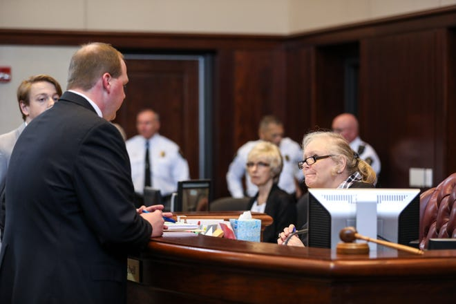 Fairfield Prosecutor Patrick Oelrick speaks with Fairfield Municipal Court Judge Joyce A. Campbell before the hearing for Tracey Abraham on Thursday March 21, 2019.