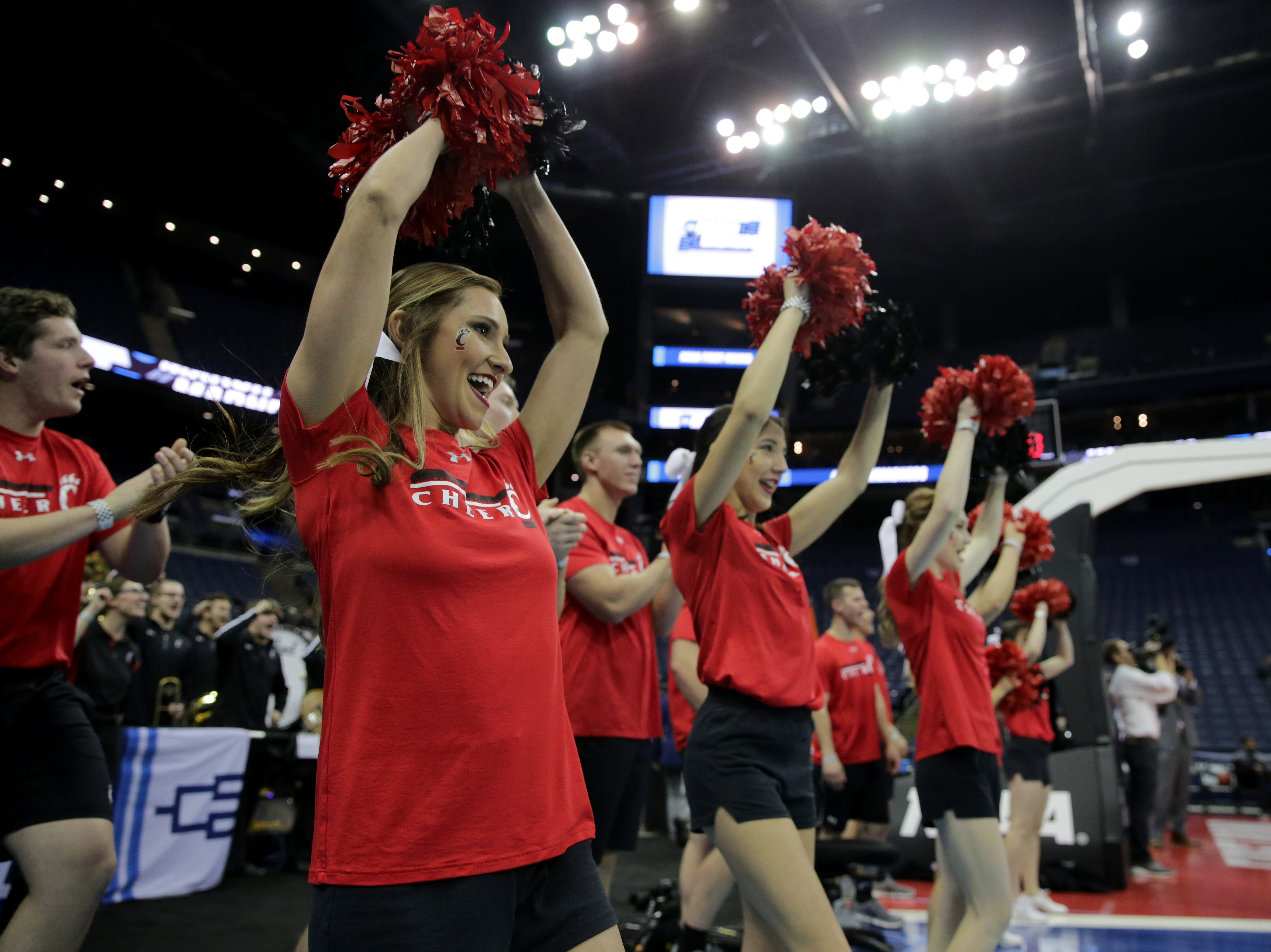 The Cincinnati Bearcats cheerleaders attend open practice, Thursday, March 21, 2019, at Nationwide Arena in Columbus, Ohio.