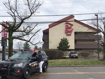 Hamilton County SWAT deployed tear gas in the Sharonville standoff incident. Officers ordered Walker to crawl toward them on the third floor of the motel.