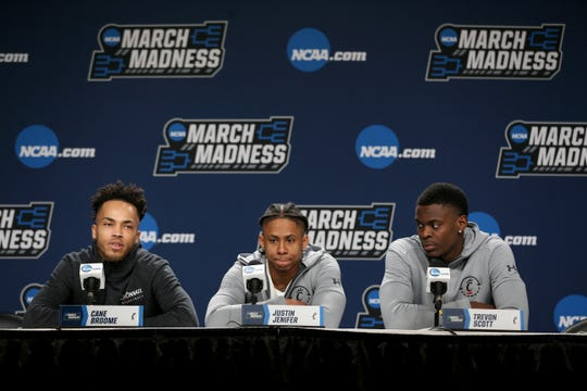 From left: Cincinnati Bearcats guard Cane Broome (15), guard Justin Jenifer (3) and Bearcats Trevon Scott (13) answer questions from the media, Thursday, March 21, 2019, at Nationwide Arena in Columbus, Ohio.