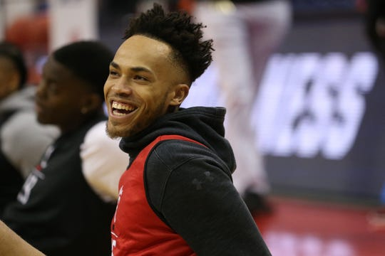Cincinnati Bearcats guard Cane Broome (15) smiles during stretching before open practice, Thursday, March 21, 2019, at Nationwide Arena in Columbus, Ohio.