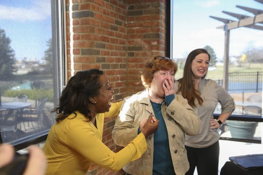 Beverly Fulkerson, middle, from Osgood, Indiana was surprised by HGTV's Tiffany Brooks with the news that she is the winner of the HGTV Dream Home Giveaway 2019, located in Whitefish, Montana.