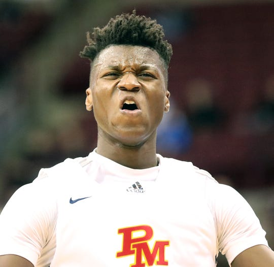Purcell Marian player Bryan Warah  reacts during the Cavaliers' state semifinal 48-41 loss to Harvest Prep, Thursday, March 21, 2019.