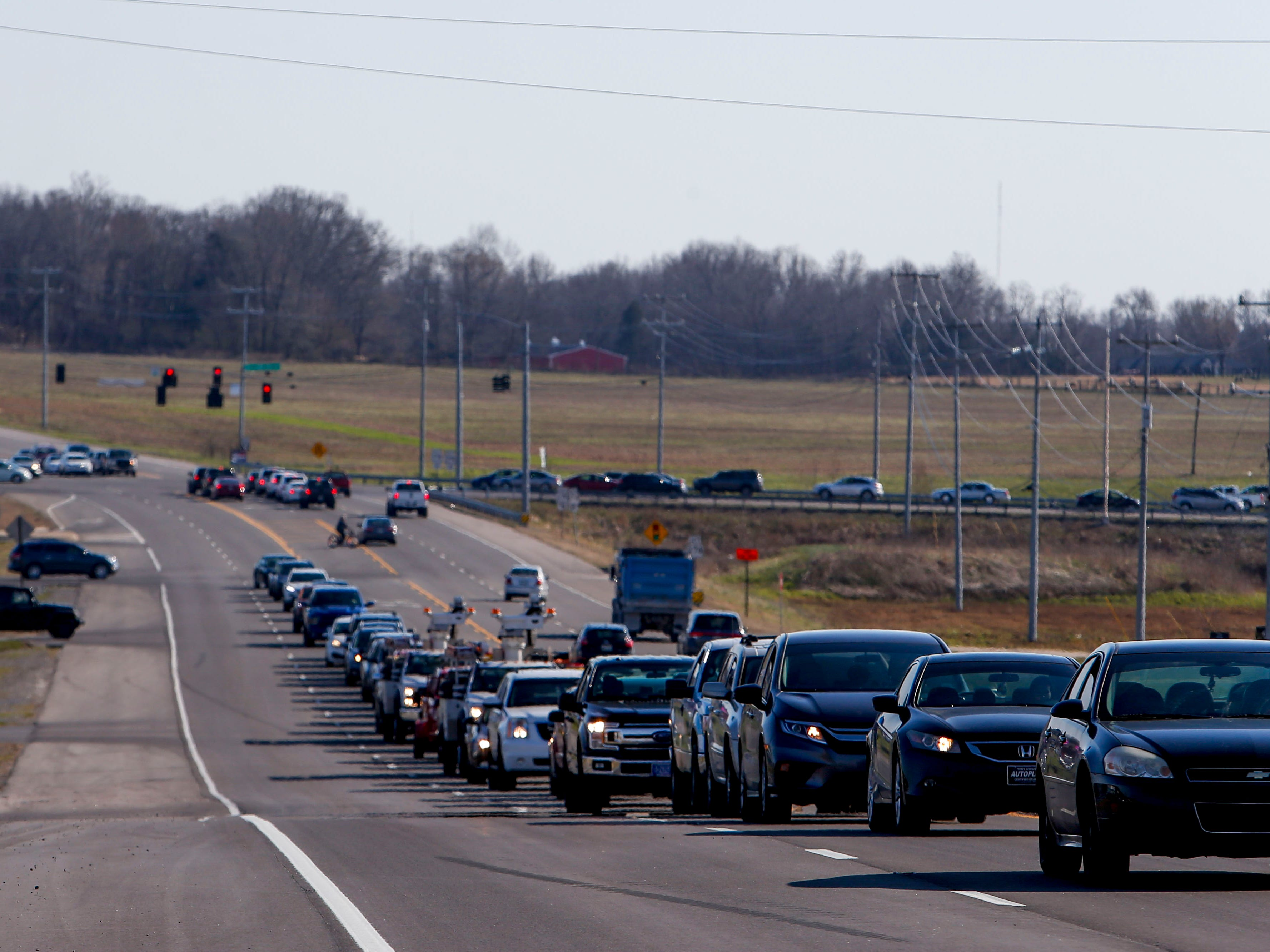 Traffic lines up down Trenton Road near Needmore Road in Clarksville, Tenn., on Tuesday, March 19, 2019. The widening of Trenton Road from north of state Highway 374 (101st Airborne Division Parkway) to south of I-24 is on the state's IMPROVEAct list of accelerated road projects.