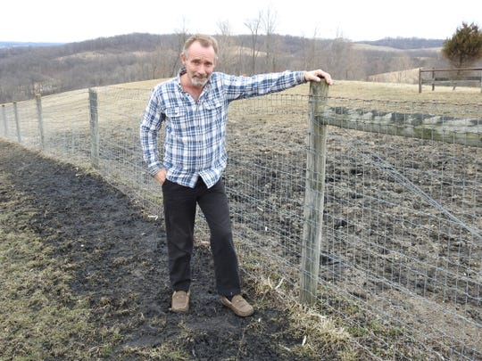 Wayne Rollyson of Township Road 253 outside Newcomerstown stands on his property, which has a black sludge substance that testing has revealed to be black carbon or coal ash. Wayne wants the material cleaned up and feels it shouldn't be his responsibility. While he's been working with the Coshocton County Health Department, he believes the Ohio EPA has been giving him the run around.