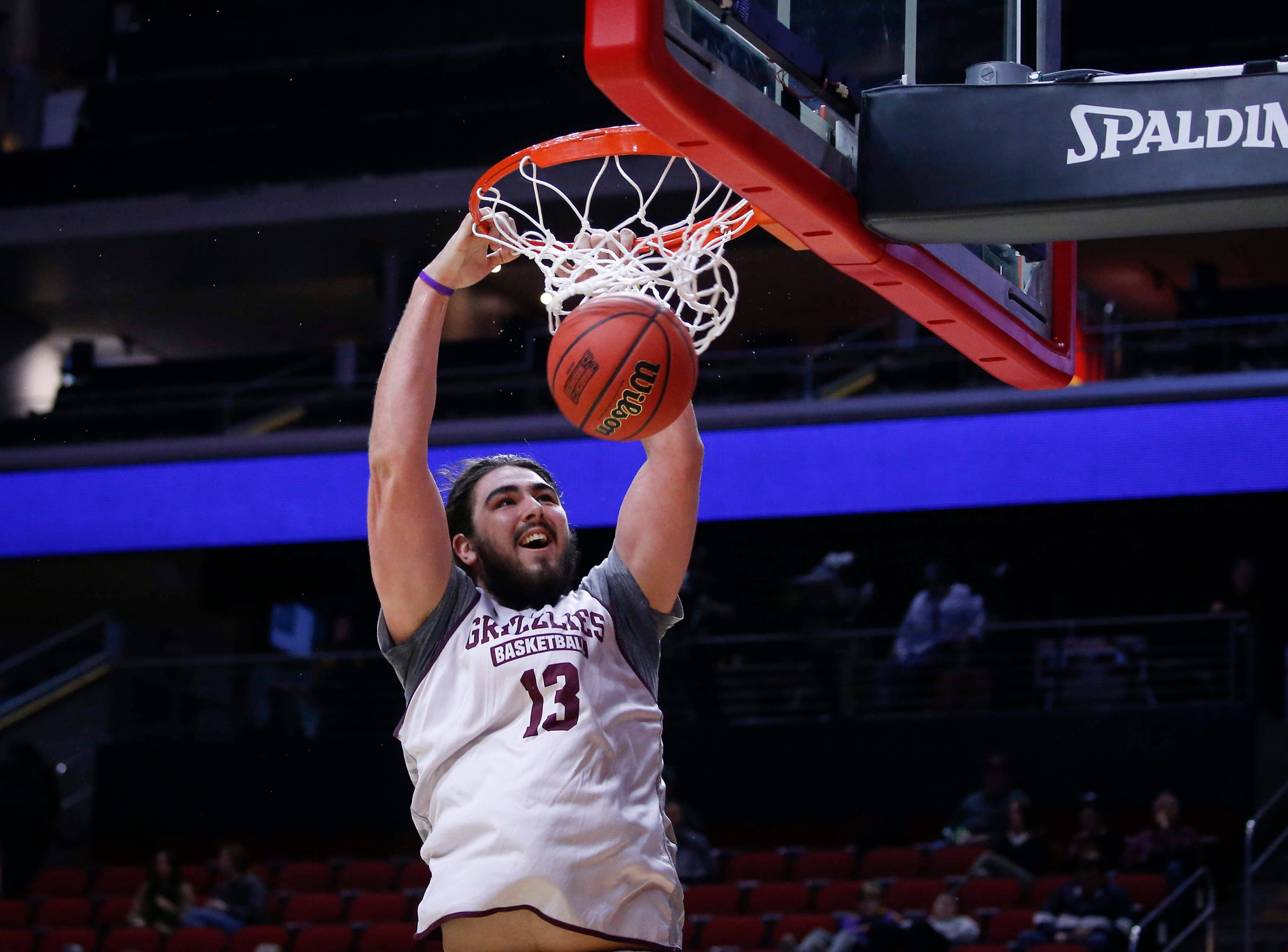 Montana freshman Ben Carter dunks the ball during open practice on Wednesday, March 20, 2019, at Wells Fargo Arena in Des Moines, Iowa.