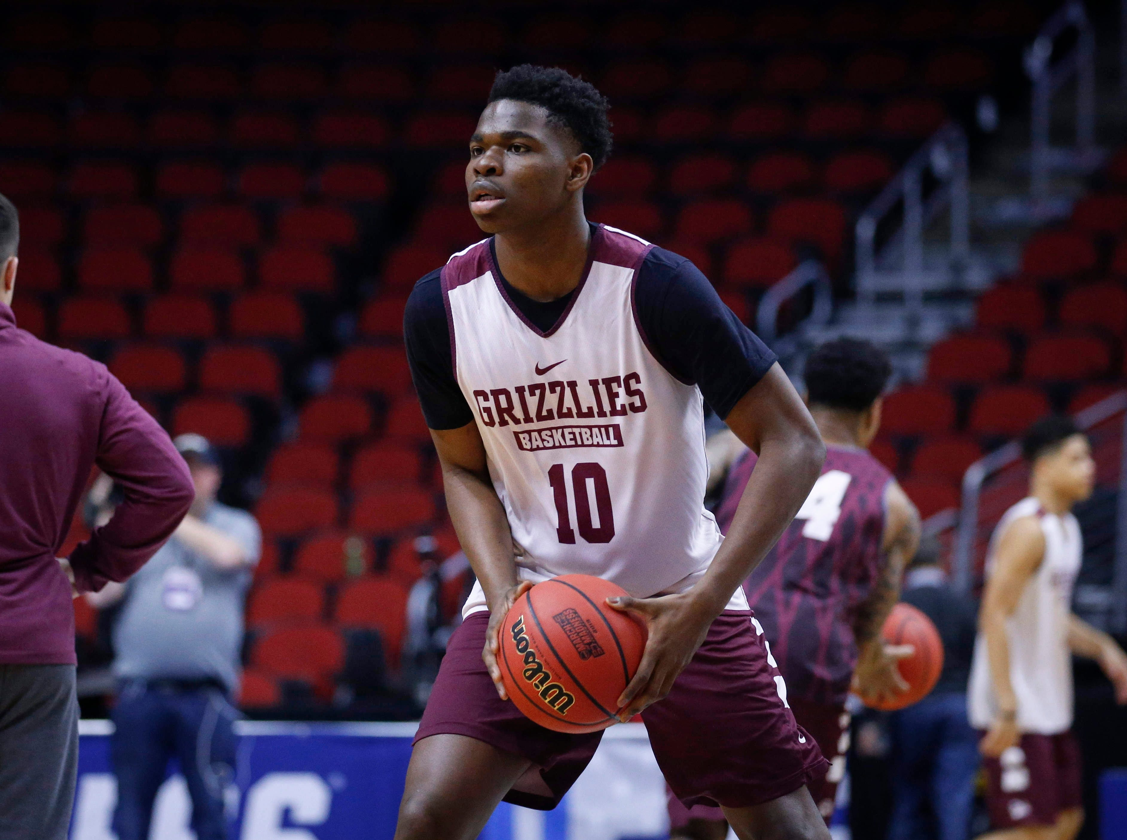 Montana freshman Eddy Egun runs a passing drill during open practice on Wednesday, March 20, 2019, at Wells Fargo Arena in Des Moines, Iowa.