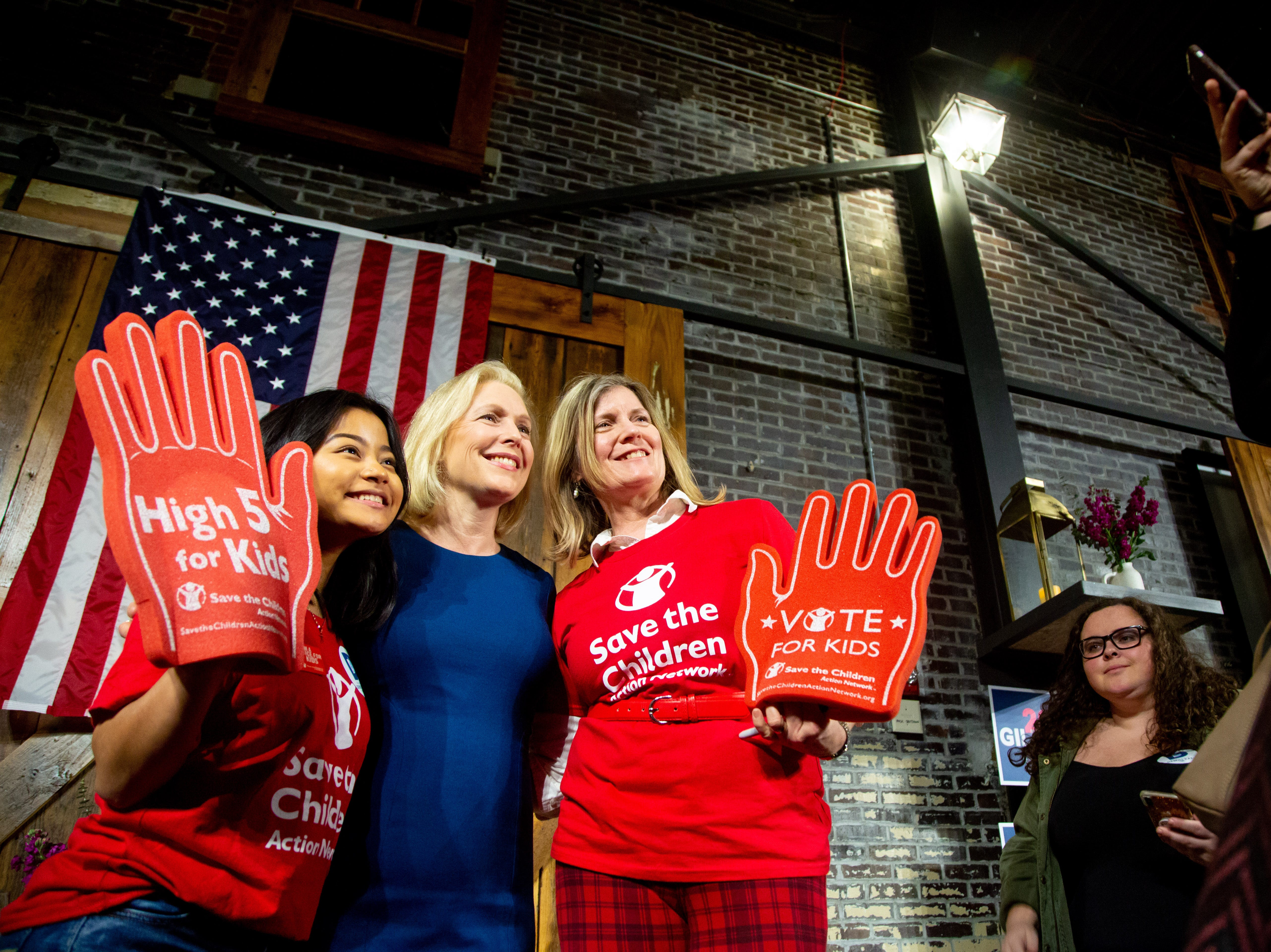 Democratic presidential candidate Sen. Kirsten Gillibrand, D-N.Y., takes a photo with Vanny Hlawn, 15, of Urbandale and Jen Statler of Ankney after a town hall in Des Moines Wednesday, March 20, 2019.