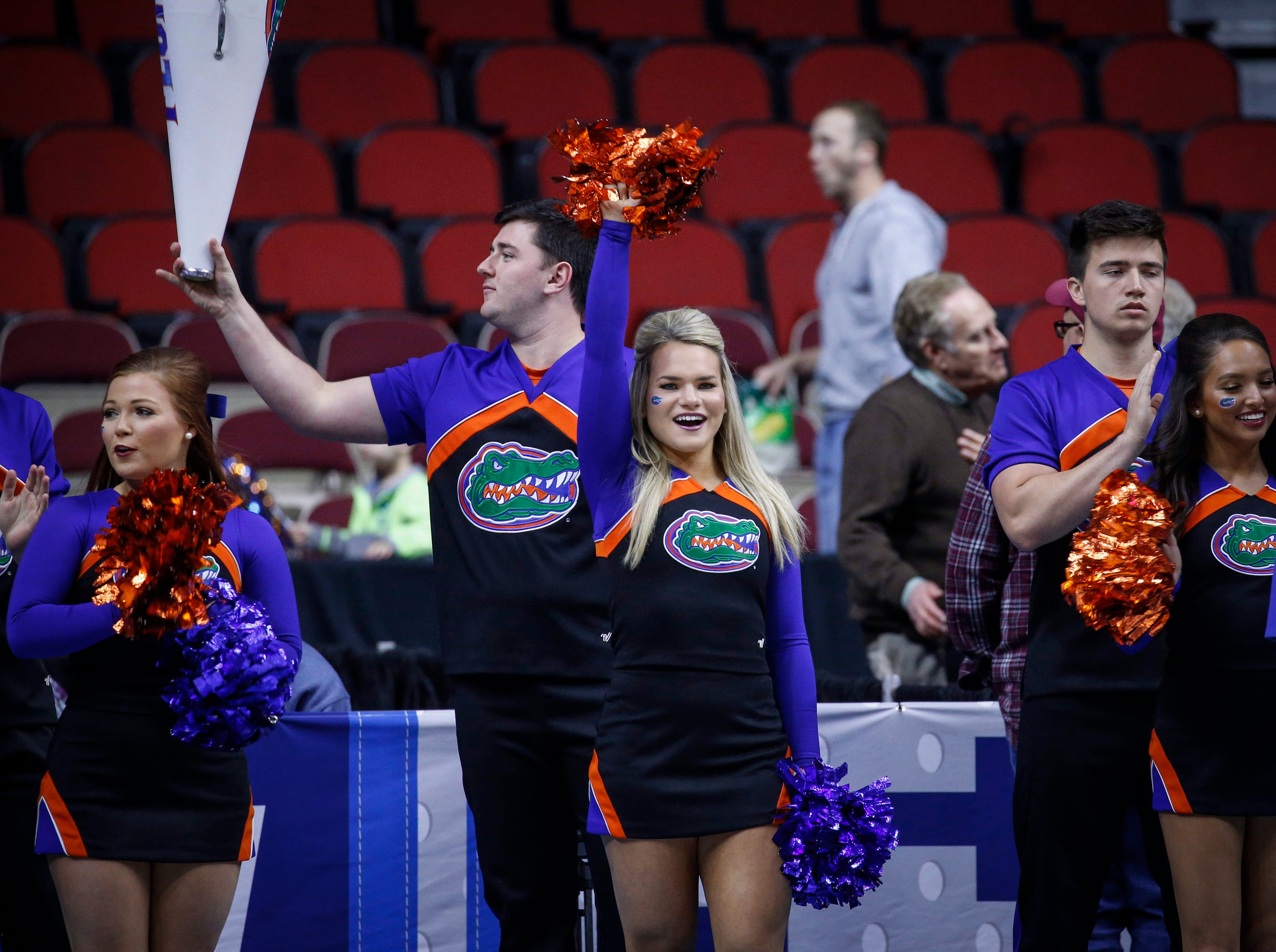 Members of the University of Florida cheer squad run a drill as the men's basketball team takes the court during practice on Wednesday, March 20, 2019, at Wells Fargo Arena in Des Moines, Iowa.